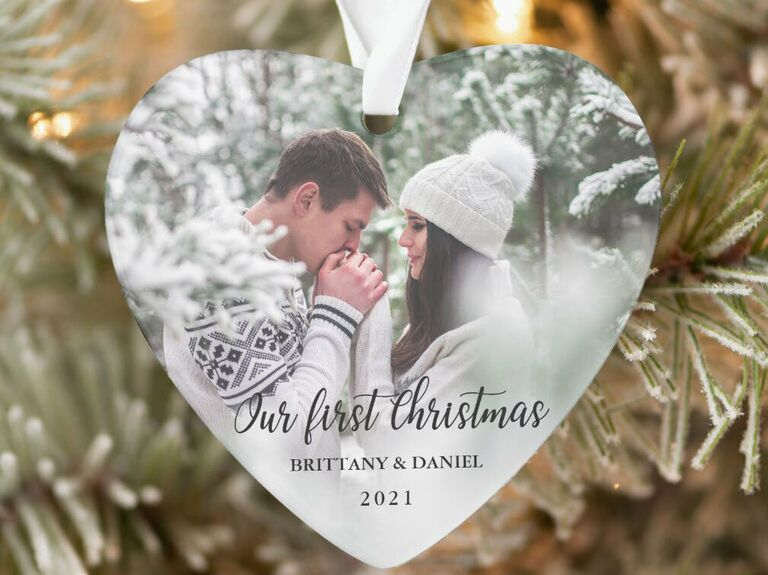 Heart-shaped ornament with personalized photo and 'Our first Christmas' in black calligraphy type