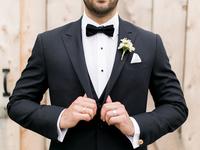groom in classic black tuxedo