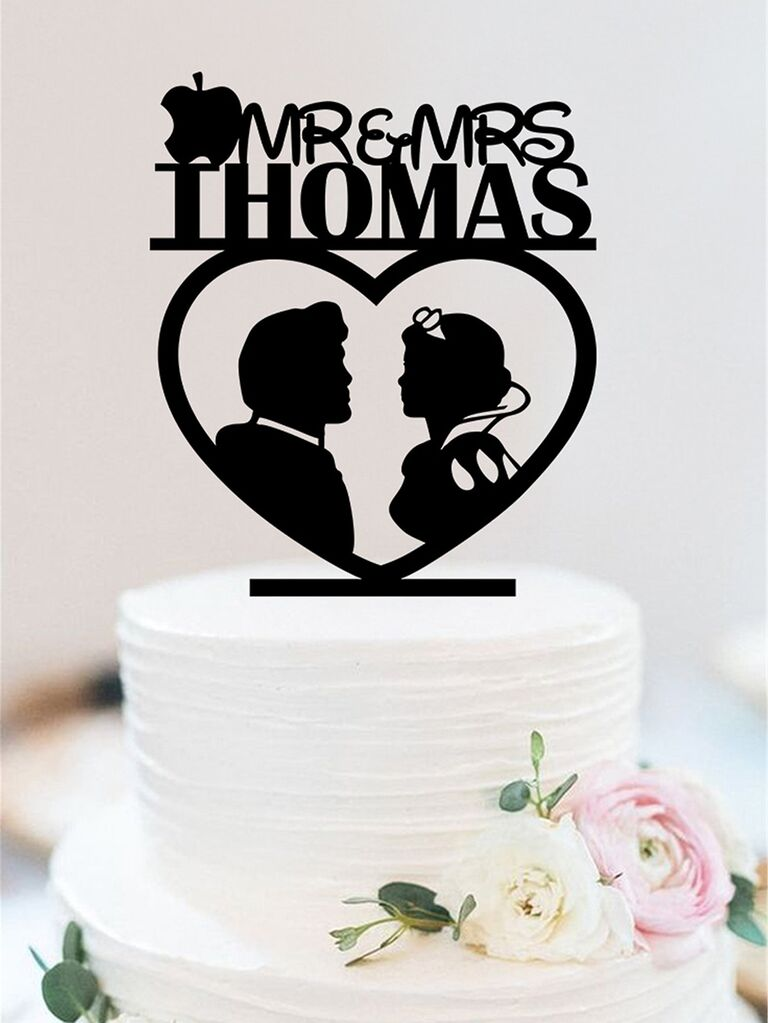 Black acrylic topper with Snow White and prince silhouettes and couple names in Disney font with apple decal
