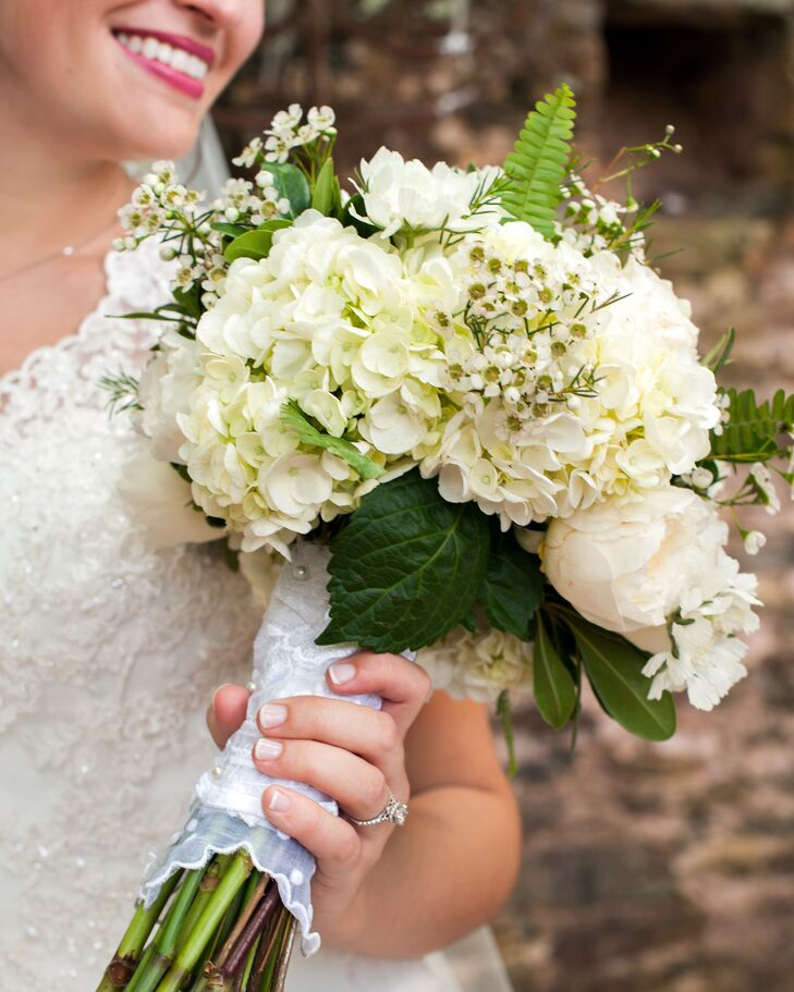 Sarah Beth's bouquet was filled with classic ivory blooms like hydrangeas, peonies and waxflowers. The bouquet was wrapped in lace taken from her mother's and grandmother's wedding dresses.