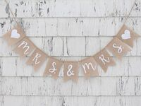 Mrs. & Mrs. on burlap pennants in simple white script with hearts at beginning and end