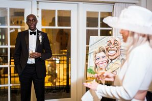 Bride and Groom Posing With a Caricature of the Newlyweds