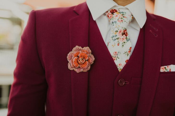 Eclectic Boutonniere on Burgundy Suit With Floral Tie