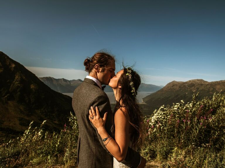 Couple kissing in mountains