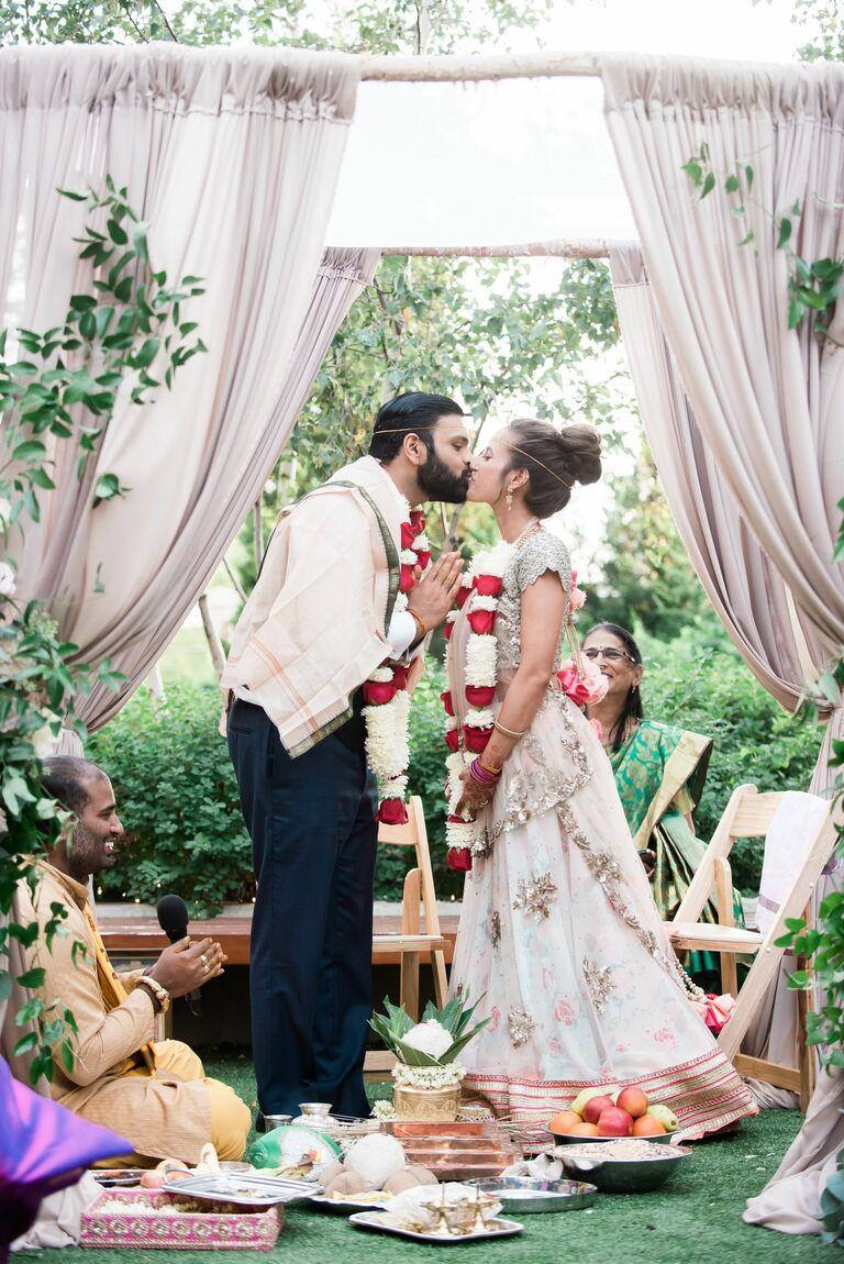 Couple kissing in mandap