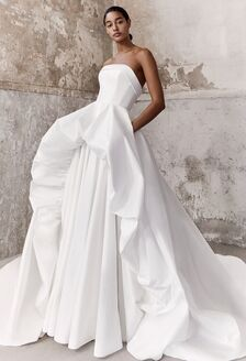 high fashion wedding dress with puffy sleeves and tiered skirt