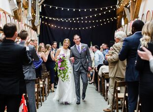 Punchy pops of purple, ombré accents and a unique distillery backdrop injected Morgan Youngs and John Butterfield's spring wedding with plenty of pers
