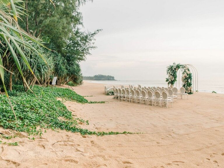 Chairs and altar arch for ceremony on the beach