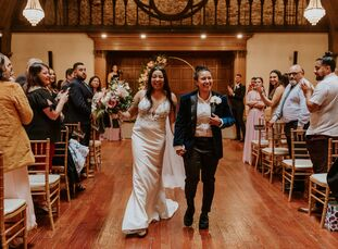 Janise Whitmore and Kelsi Barron looked to the stars when planning their wedding in California, coming up with a celestial theme and navy, mauve and g