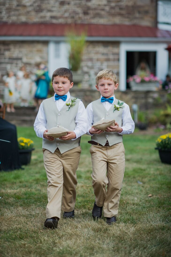 Caitlin and Sean's ring bearers complemented the groomsmen's neutral looks and blue ties with fun, bright blue bow ties, neutral pants and pale green vests. Their burlap ring pillows also tied in the couple's Southern-style theme with a simple touch.