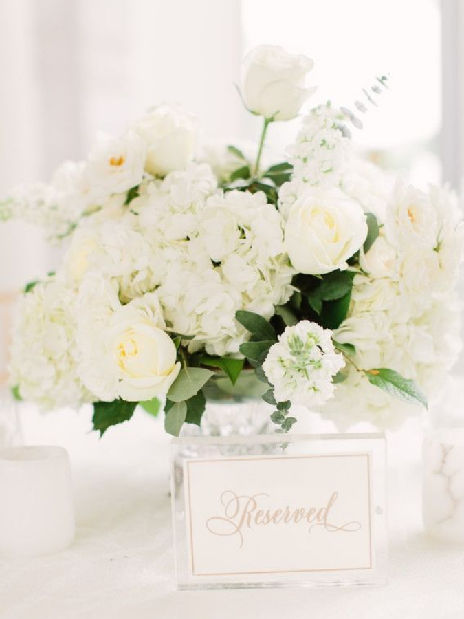 All-white centerpiece and acrylic table number