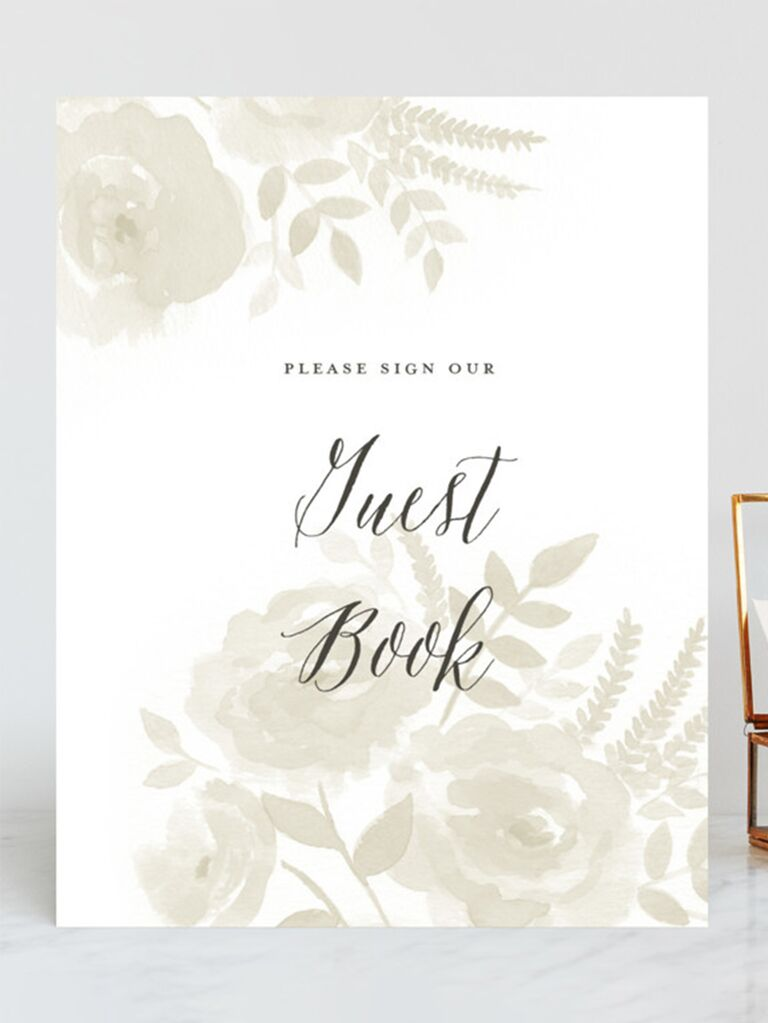 Watercolor florals in light green with 'Guest Book' in elegant cursive