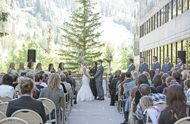 """Miranda and Eric said """"I do"""" outdoors with a stunning mountain backdrop. Their officiant customized their ceremony after a series of interviews together and apart, and prepared a wine box for Miranda and Eric to save letters to each other, which they will open on their 10th anniversary."""