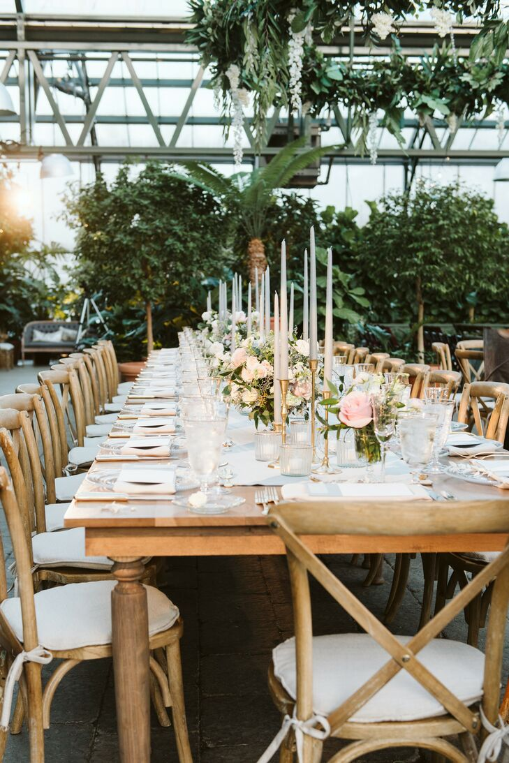Romantic Dining Table with Taper Candles, Flower Centerpieces and Cross-back Chairs