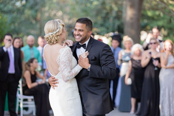"""Amanda stunned in a formfitting lace gown with a deep V back and long lace sleeves. """"I love the classic 1920s look, so my wedding attire was inspired by that era,"""" says Amanda."""
