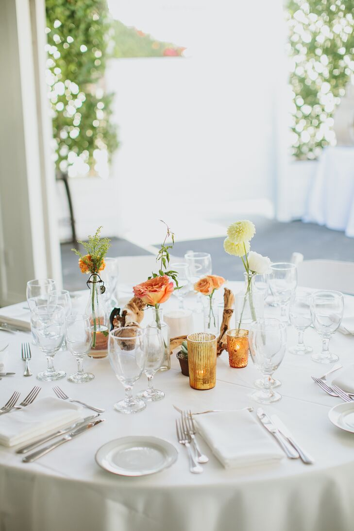 """""""Our reception decor had more of a desert-boho vibe,"""" Gwynne says. """"It was an eclectic combination of vintage bud vases and olive wood branches with copper and gold votives."""""""