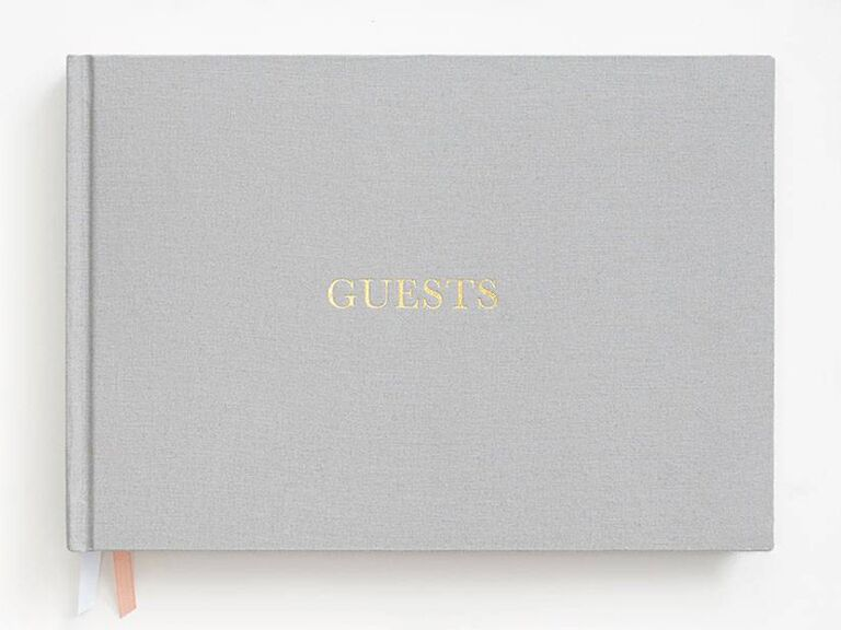 paper source grey simplistic wedding guest book idea with gold lettering and bookmark