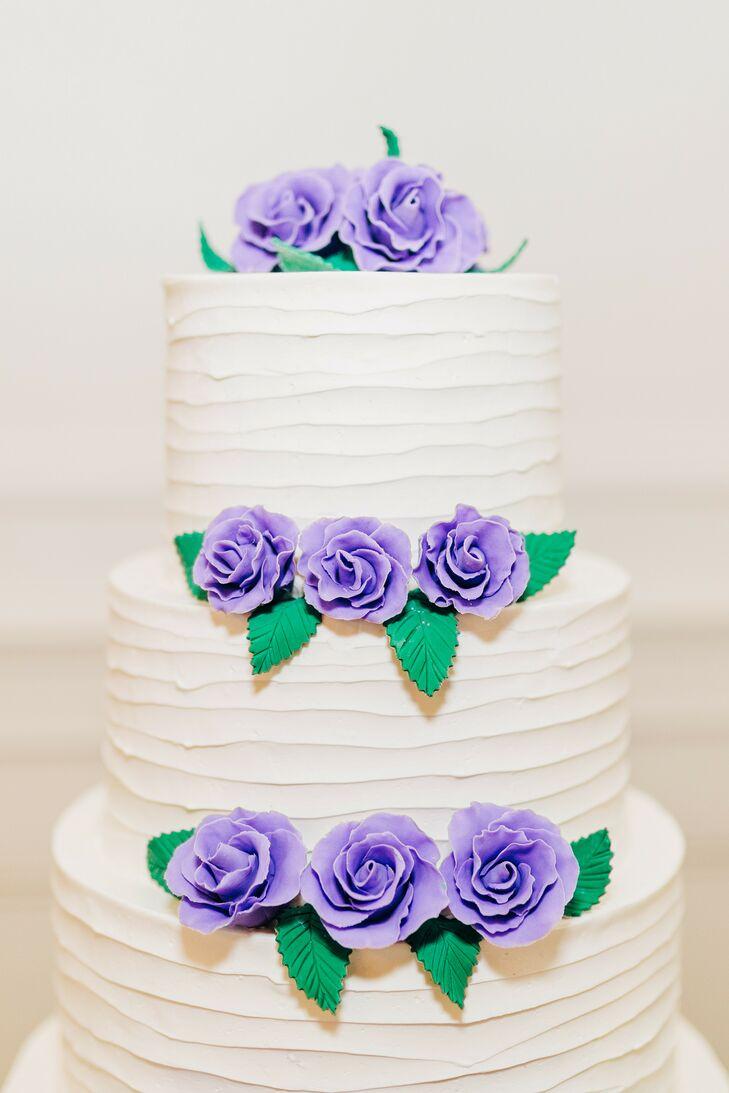 Three-Tier Wedding Cake With Purple Sugar Flowers