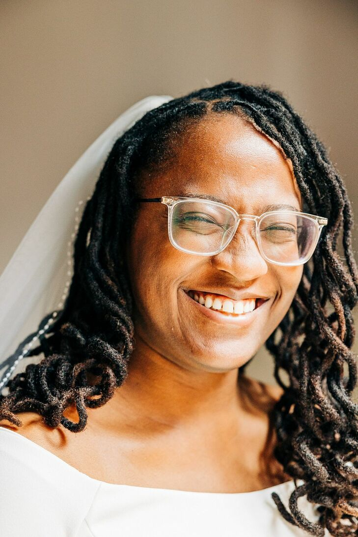 Bride With Long Hair Wearing Veil and Glasses