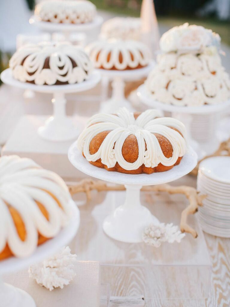 Spread of vintage-inspired bundt wedding cakes with white icing