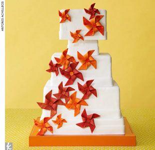 Orange, red and white pinwheel wedding cake