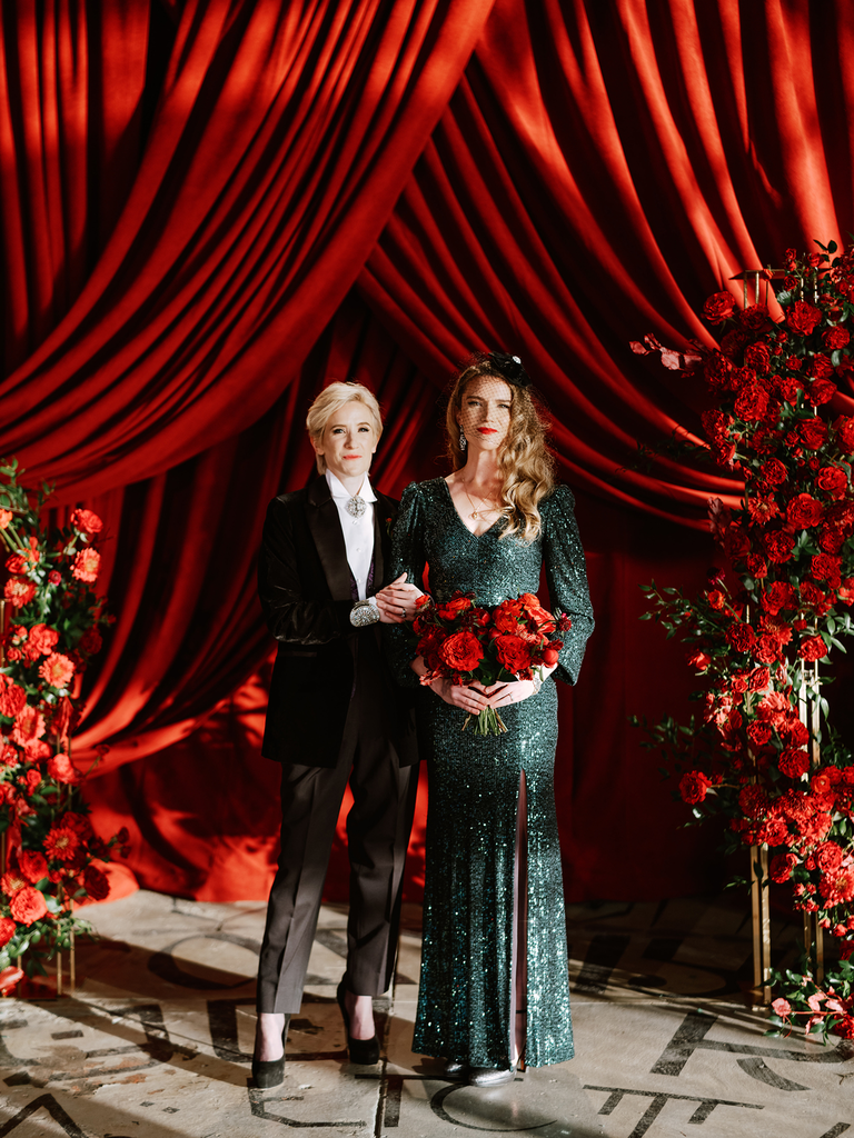 how to choose a wedding photographer couple with flowers