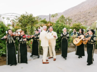 Grooms dancing while Mariachi band plays