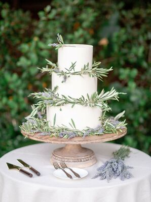 Rustic Tiered Cake Decorated with Lavender on Wood Stand