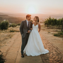 bride in spaghetti strap ball gown with groom
