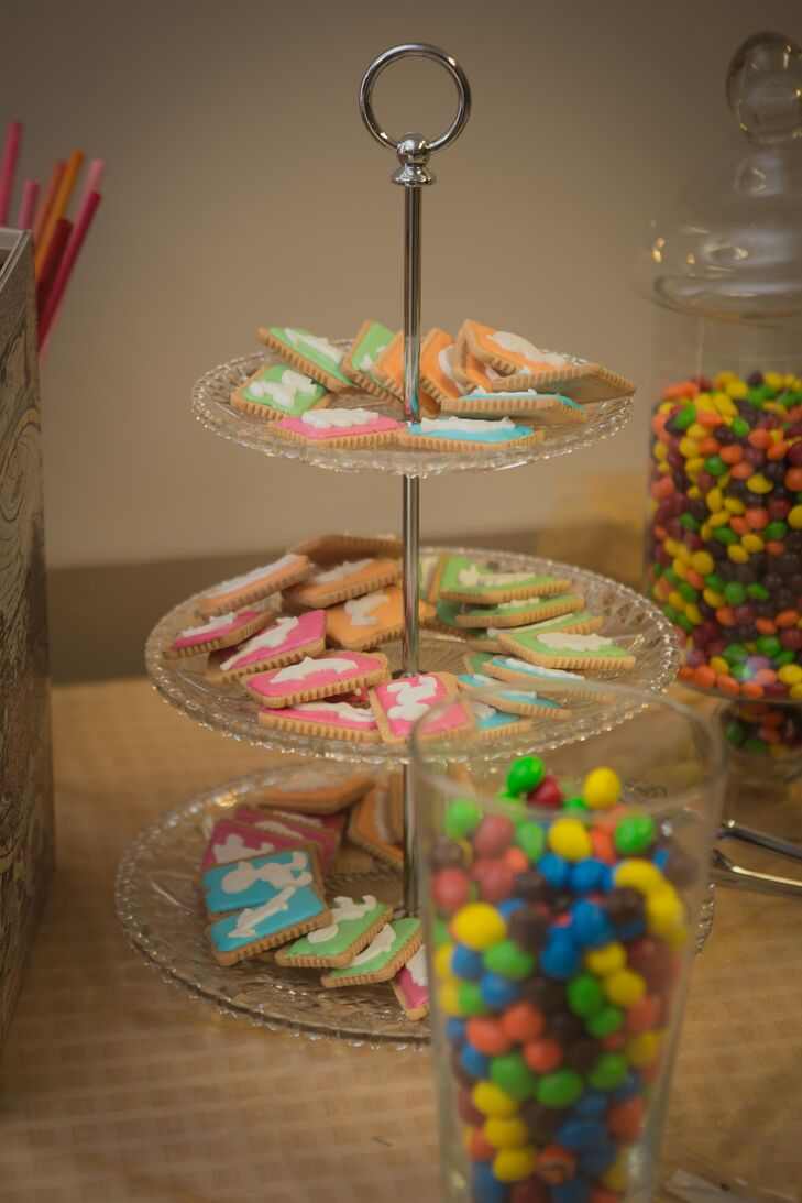 Trays and jars of cookies and candies were offered to guests as a delicious sweet treat in addition to the cake.
