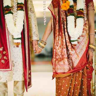 Hindu bride and groom in traditional wedding clothes