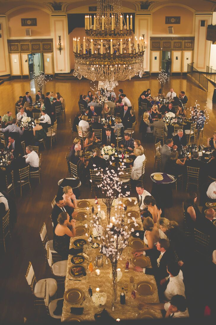 """Laurie and AJ invited friends and family members for a ballroom reception at Detroit's historic Masonic Temple. """"We went to a holiday party there a few years ago and fell in love with the architecture,"""" Laurie says."""