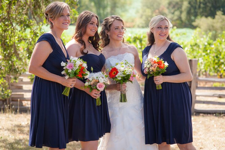 Kirstin stood next to her three bridesmaids, who wore navy blue dresses with different styles.
