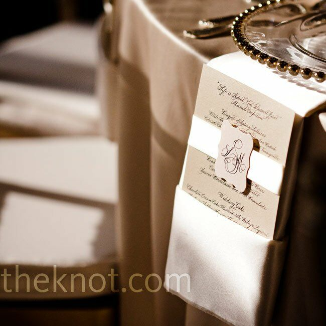 Gold-beaded glass chargers sat atop drop-down menus, which were marked with the couple's intricate calligraphy monogram.