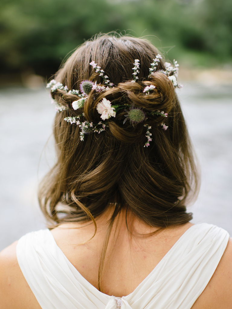 country wedding hairstyles half up with wildflowers