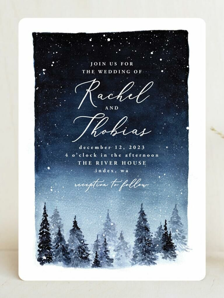 Affordable winter wedding invitation depicting snowy forest scene