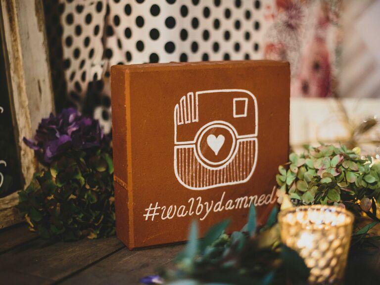 Brick block wedding hashtag sign on reception table