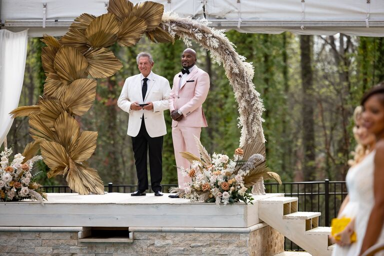 jeezy awaits jeannie at the beautiful arbor with officiant