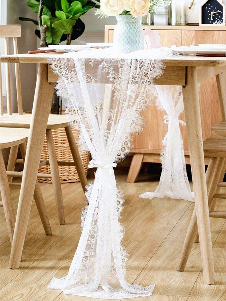 Delicate white lace table runner with rose details