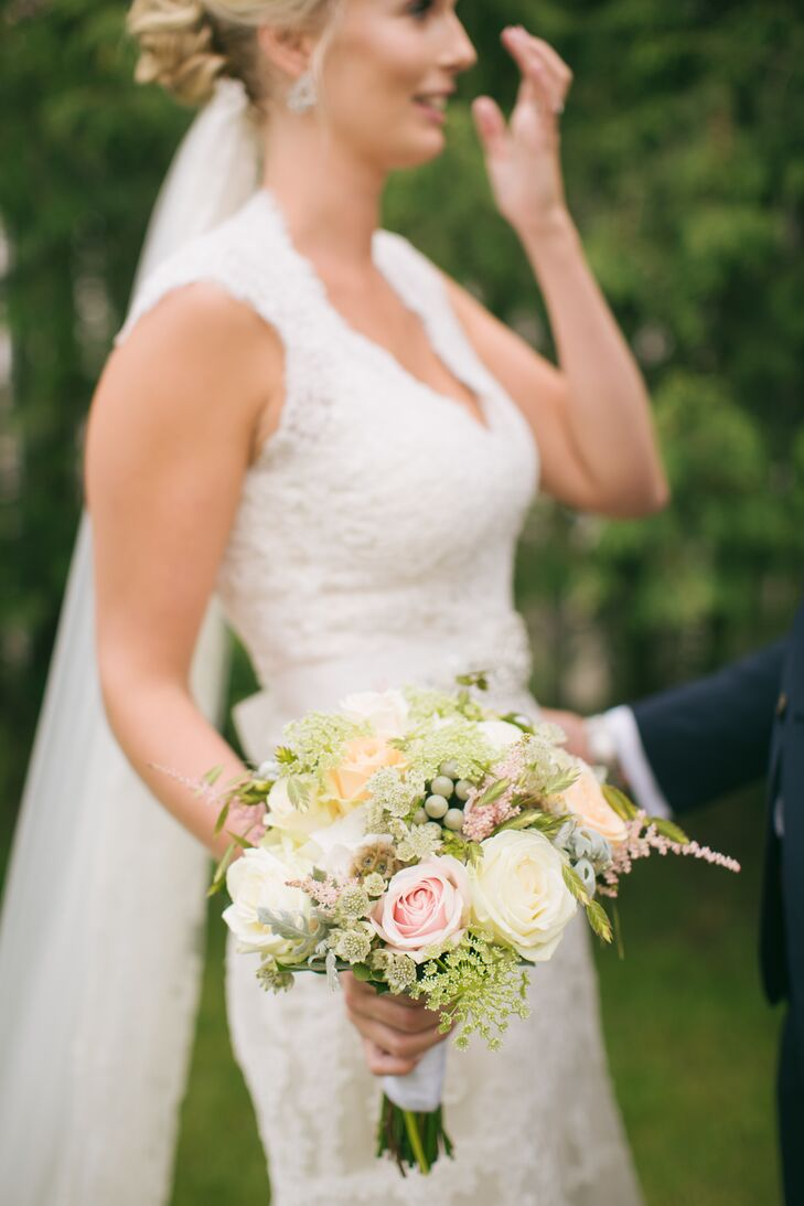 Ulrika carried roses, scabiosa pods, dusty miller, queen anne's lace and silver brunia balls in her lush bouquet. She loved how the flowers added a textured wildflower vibe, which complemented the countryside venue.