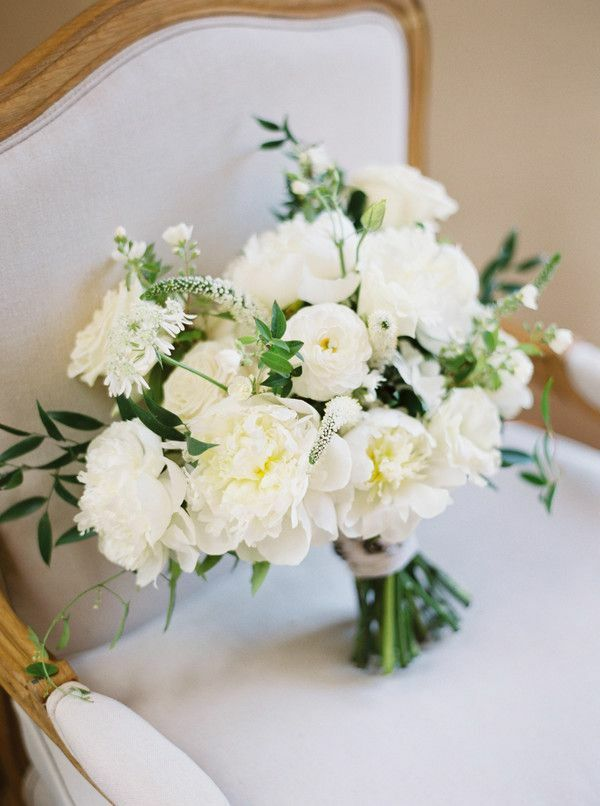 Classic white-and-green bouquet sitting on chair