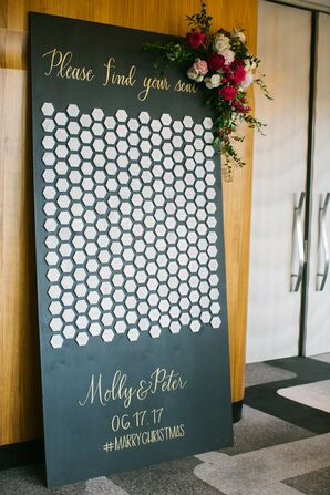 Hexagon Shaped Escort Cards on Black and White Wall