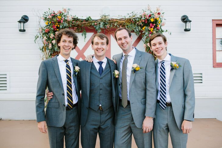 The groomsmen all wore gray suits with a navy, yellow and silver striped tie of their choice.