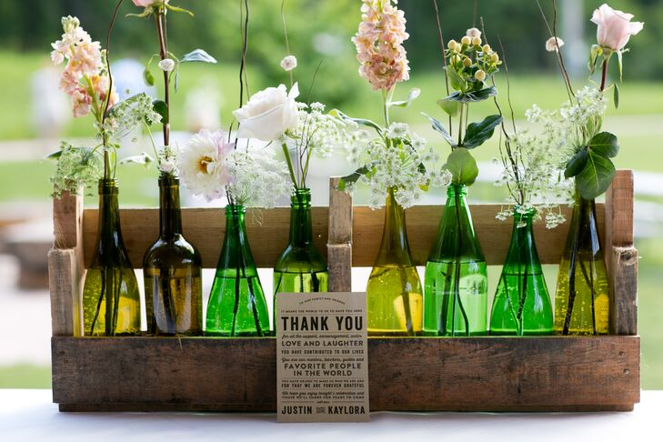 An assortment of roses and wildflowers were displayed in bud vases for a rustic, relaxed look.