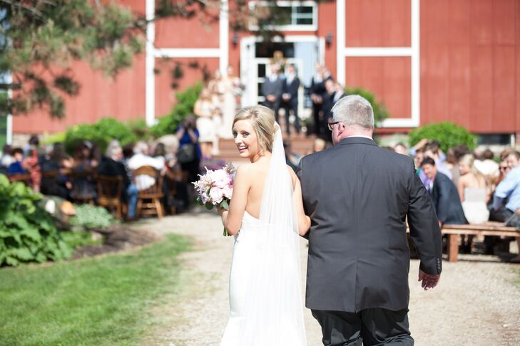 """Erin chose to walk down the aisle alongside her father to a song she considers a childhood favorite. """"I walked down the aisle to 'Somewhere Over the Rainbow' by Teea Goans, which was a song I would sing over and over again as a little girl,"""" Erin says."""
