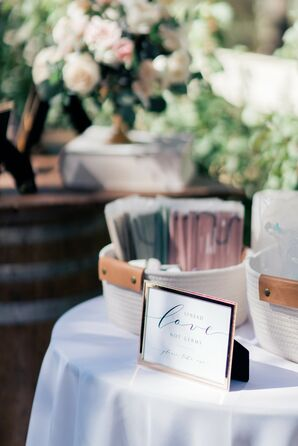 Face Masks and Sign at Wedding Welcome Table