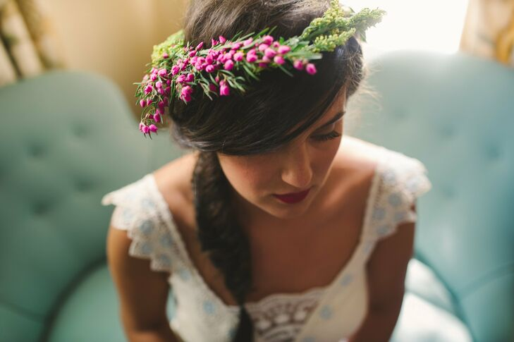 The bride wore her hair in a side fishtail braid with a simple floral crown.