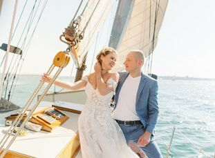 Elena and Art took to the sea for their vows. The couple tied the knot in front of an intimate group of friends while aboard a sailboat off the coast