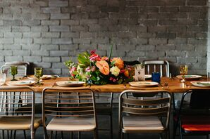 Modern Dining Table with Tropical Centerpiece and Mismatched Chairs