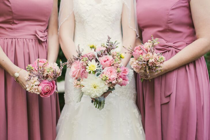 Madeline's Flower Shop created these whimsical dark blush and ivory bouquets for Chelsea and her bridal attendants that looked like they'd been swept up from a meadow. The arrangements included roses, dahlias, stock, wax flowers and dusty miller.